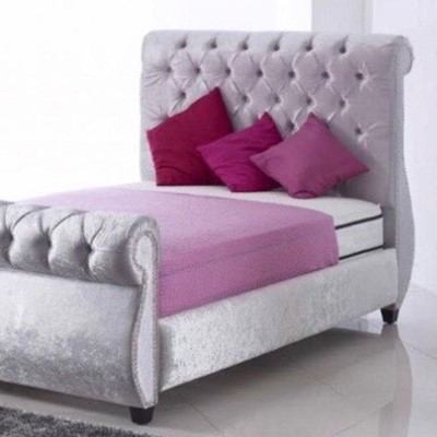 Grey Bed with Pink Sheets